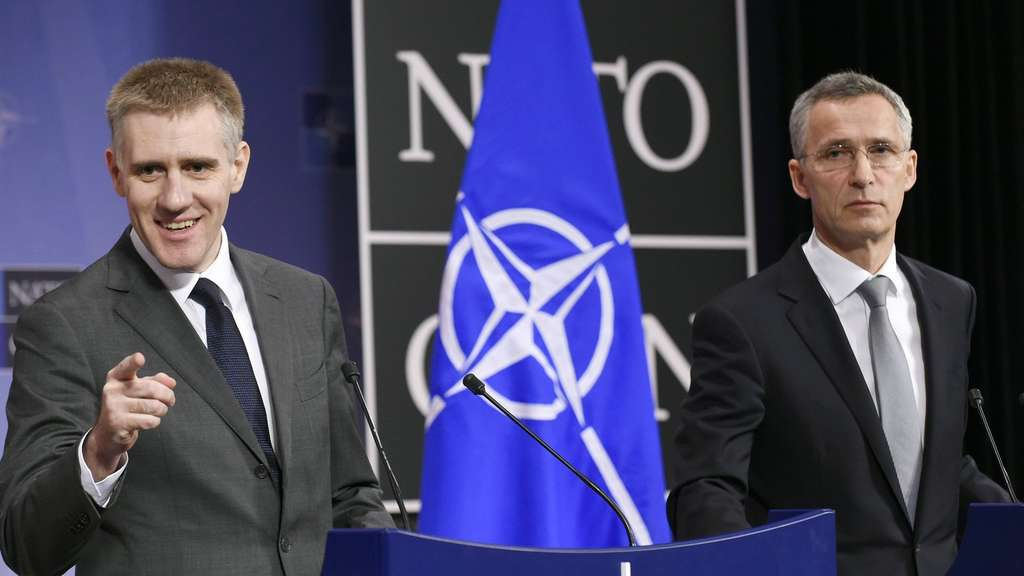Montenegro&#39s Deputy Prime minister and Minister of Foreign Affairs and European Integration Igor Luksic (L) and NATO Secretary General Jens Stoltenberg give a joint press conference during the second day of the Foreign Affairs meeting on the Nato-Ukraine Commission at the NATO headquarters in Brussels on December 02, 2015. / AFP / JOHN THYS